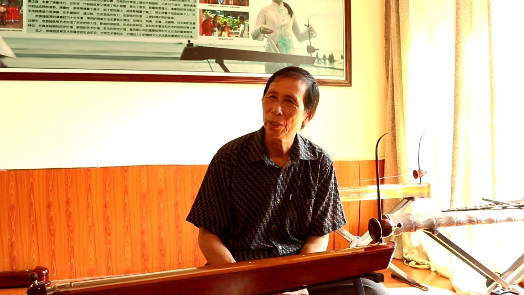 Instrumento Duxianqin da etnia Jing