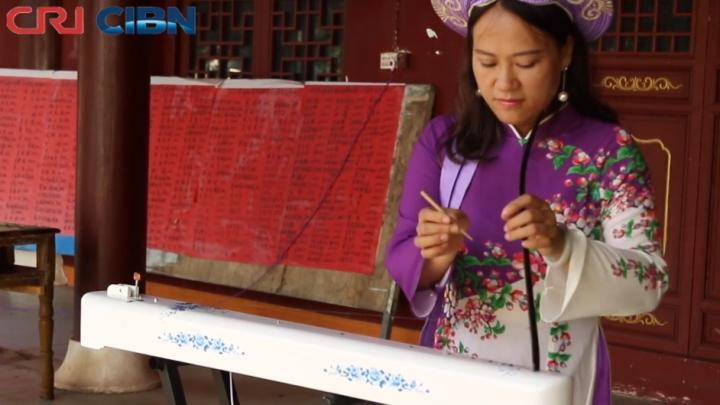 Duxianqin, instrumento musical transmitindo cultura da minoria étnica de Jing